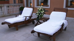 Dolly shot of lounge chairs on a deck in Venice. Stock Footage