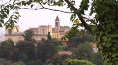 Buildings in Rome Italy with trees in the foreground. Stock Footage