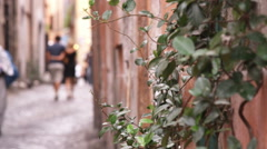 Couple walking down a street in Rome Italy. Stock Footage
