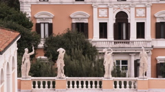 Statues on the roof of a building in Rome Italy. Stock Footage