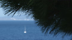Far shot of a boat on the water in Punta Ala Italy. Stock Footage
