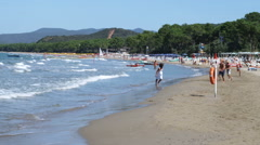Kids running on the beach in Punta Ala Italy. - stock footage