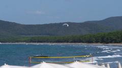 Parasail in the air near a beach at Punta Ala Italy. Stock Footage