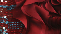 Close-up shot of red satin fabric and beads. - stock footage