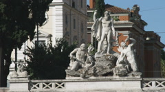 Stock Video Footage of Ancient fountain and buildings in Rome Italy.
