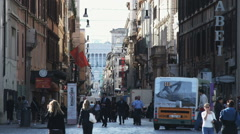 Alley between city buildings with a small crowd in Rome. Stock Footage