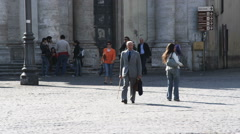 Business man walking through a plaza in Rome Italy. Stock Footage
