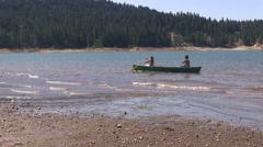 Paddling the canoe along the shore - stock footage