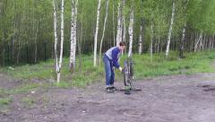 Teenager bike repairs Stock Footage