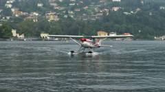 Shot of an airplane skimming across Lake Como in Italy. Stock Footage