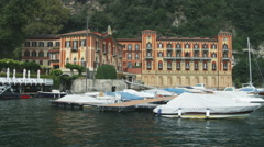 Hotel on Lake Como near a docking area in Italy. Stock Footage