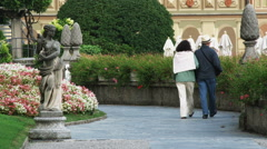 People walking through gardens near Lake Como in Italy. Stock Footage
