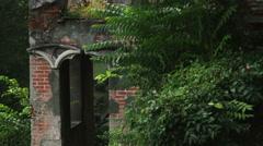 Tilt up an archway in an Italian garden near Lake Como. Stock Footage
