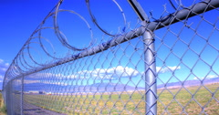 Stock Video Footage of Chainlink Fence Airport Timelapse