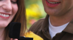 Clip of a man proposing to a woman in a beautiful garden. Stock Footage