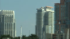 Goodyear blimp appearing from behind a Miami hotel. Stock Footage