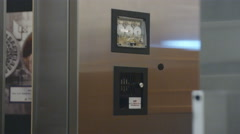 Close-up shot of door shutting with safe in background. Stock Footage