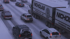 Stock Video Footage of Vehicles driving in a winter storm.