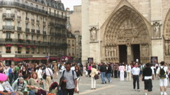 People walking through and sitting in a public plaza. - stock footage