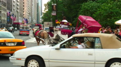 Cars taxis and a horse and carriage in New York City. Stock Footage