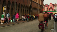 Pedestrians and cyclists on a street in Bruges Belgium. Stock Footage