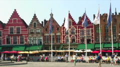 Colorful buildings and flags at Market Square in Bruges Belgium. Stock Footage