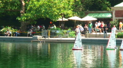 Toy sailboats on a pond in Central Park New York City. Stock Footage