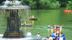 People in boats near Bethesda Terrace in Central Park NYC. Stock Footage