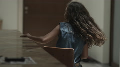 Girl playing with small chair Stock Footage
