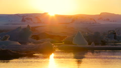 Sunset Over Melting Icebergs. Climate Change Global Warming Concept. Stock Footage
