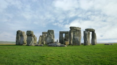 Wide time-lapse of Stonehenge with white clouds. Stock Footage