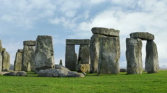 Time-lapse of Stonehenge with white clouds. - stock footage