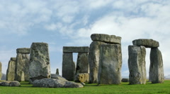 Tilting time-lapse of Stonehenge with white clouds. - stock footage