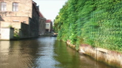Time-lapse of a boat going down a canal in Bruges Belgium. Stock Footage