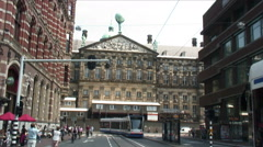 Trams passing the Palace of Amsterdam. Stock Footage