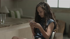 Girl playing with mobile phone Stock Footage