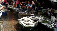 Milkfish Street Vendor seated Stock Footage