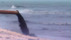 Raw sewage pouring into the ocean. Stock Footage
