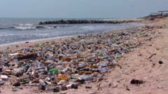 Polluted beach in Africa. Stock Footage