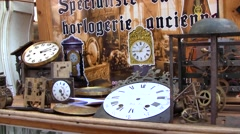 Old Clocks at a Brocante or Flea Market, France Stock Footage