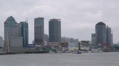 Stock Video Footage of Skyscrapers with huge company logos alongside Huangpu