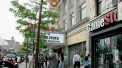 crowded Harlem during day outside Apollo Theater 125th Street slow motion 4K NYC - stock footage
