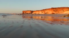 Stock Video Footage of Sunset mirror image cliff coast beach Australia
