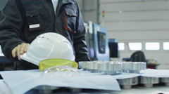 Factory Worker is Putting On Hard Hat and Safety Glasses Stock Footage