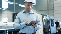 Engineer in Hard Hat is Using Tablet PC on Factory Stock Footage