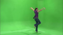 Clip of a girl dancing on a green screen in a purple shirt. Stock Footage