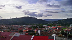 Stock Video Footage of Timelapse of the city of Cuenca, Ecuador with rolling clouds in the distance.