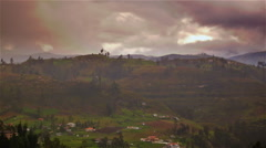 Timelapse of the Ecuadoran countryside with few dwellings and a mountain in the Stock Footage