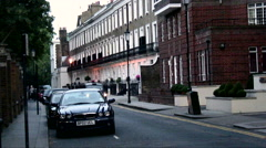 Taxi drives down a narrow street in London. Stock Footage