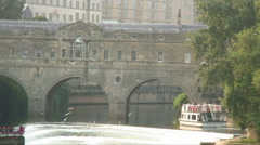 Ferry driving under a bridge in England. Stock Footage